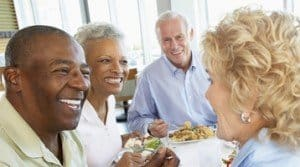 Baby Boomer Generation Seniors eating together