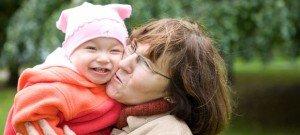 Grandma kissing baby granddaughter