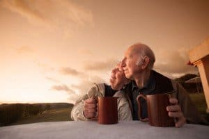 senior couple with coffee at runrise