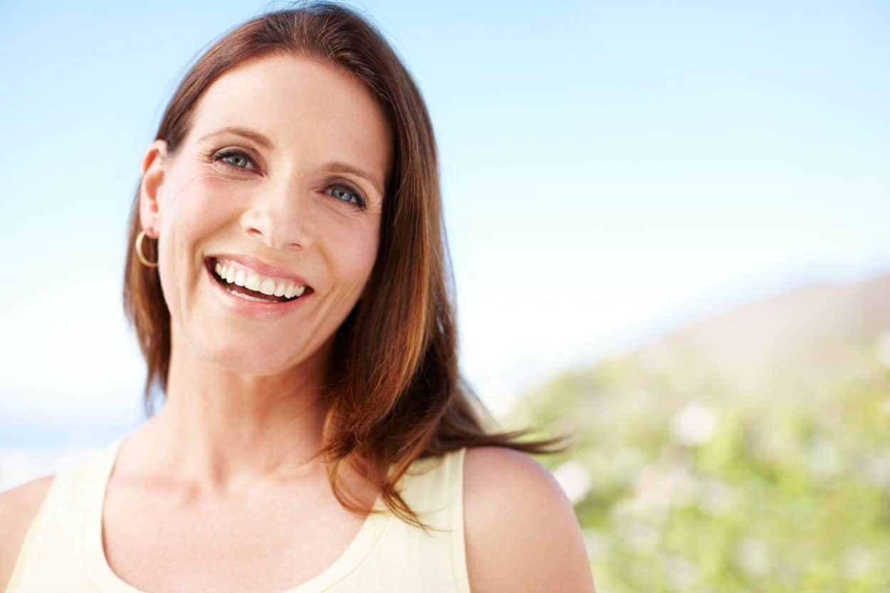 Baby boomer woman smiling outdoors